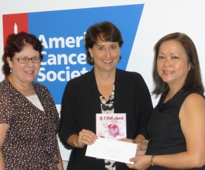 American Cancer Society's Lani Almanza and Cathy Alsop accept a check from Karen for Hope Lodge Hawaii's capital campaign.